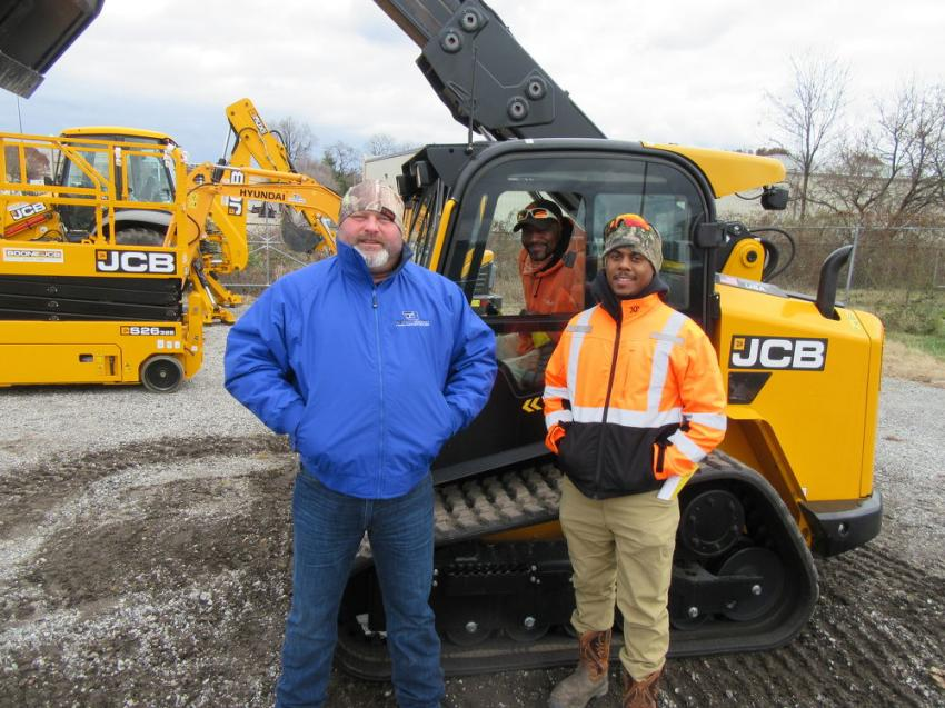(L-R): Team Boone's Jeff Willis, on hand at the auction with an equipment display, spoke with Lee Davidson and Kendrick Lancaster of NeatLeeDone Lawn & Landscape about the dealership's lineup of JCB and Hyundai equipment.