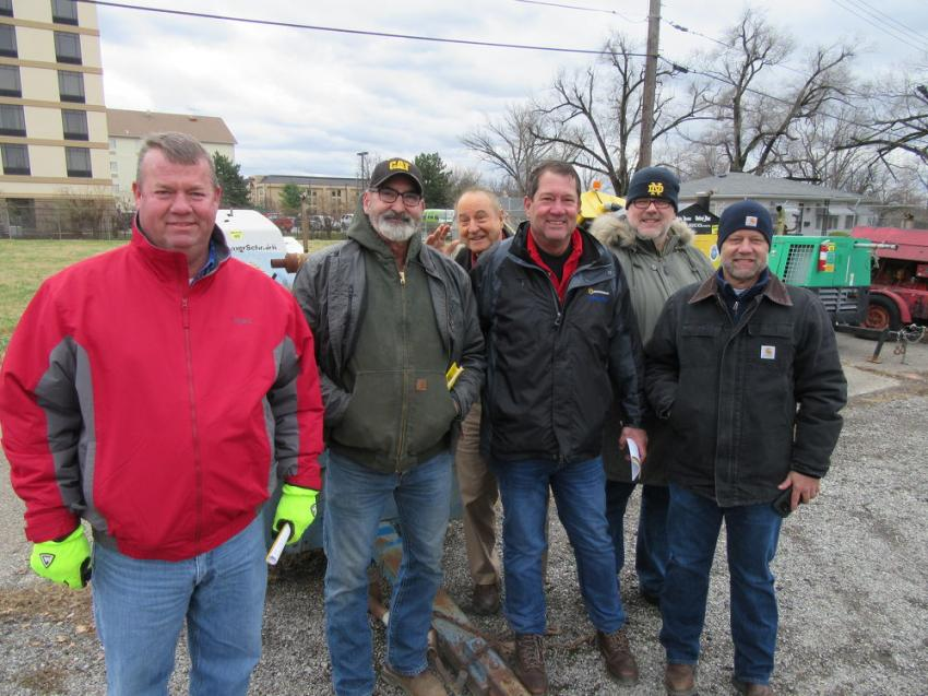 (L-R): Rod Kiefer of Sedam Contracting, Guy Stotts of Vogt Dosposal, Bob and John Liter of Liter's Inc., Dave Wicking of R3, and Barry Hornback of Liter's Inc. caught up with each other at the auction.