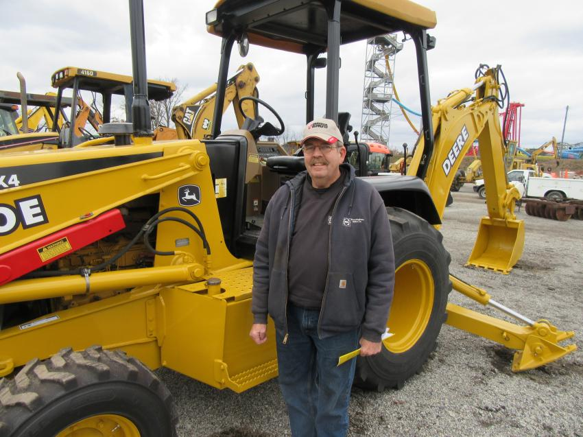 Paul Brantingham of Brantingham Builders takes a closer look at the John Deere 310E backhoe at the auction.