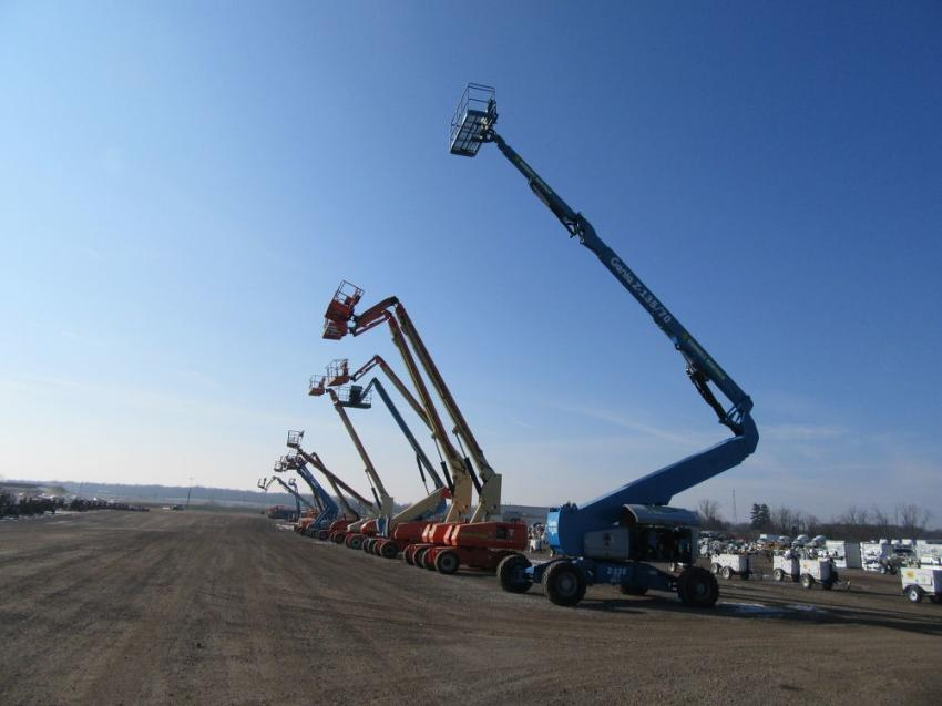 A lineup of manlifts stands ready to go up for bid.