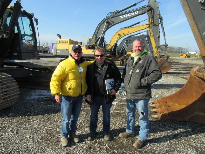 (L-R): Chris Johnson of Chris Johnson Equipment talks equipment with Ron Blair and Kelly Long of Double Jay Construction.