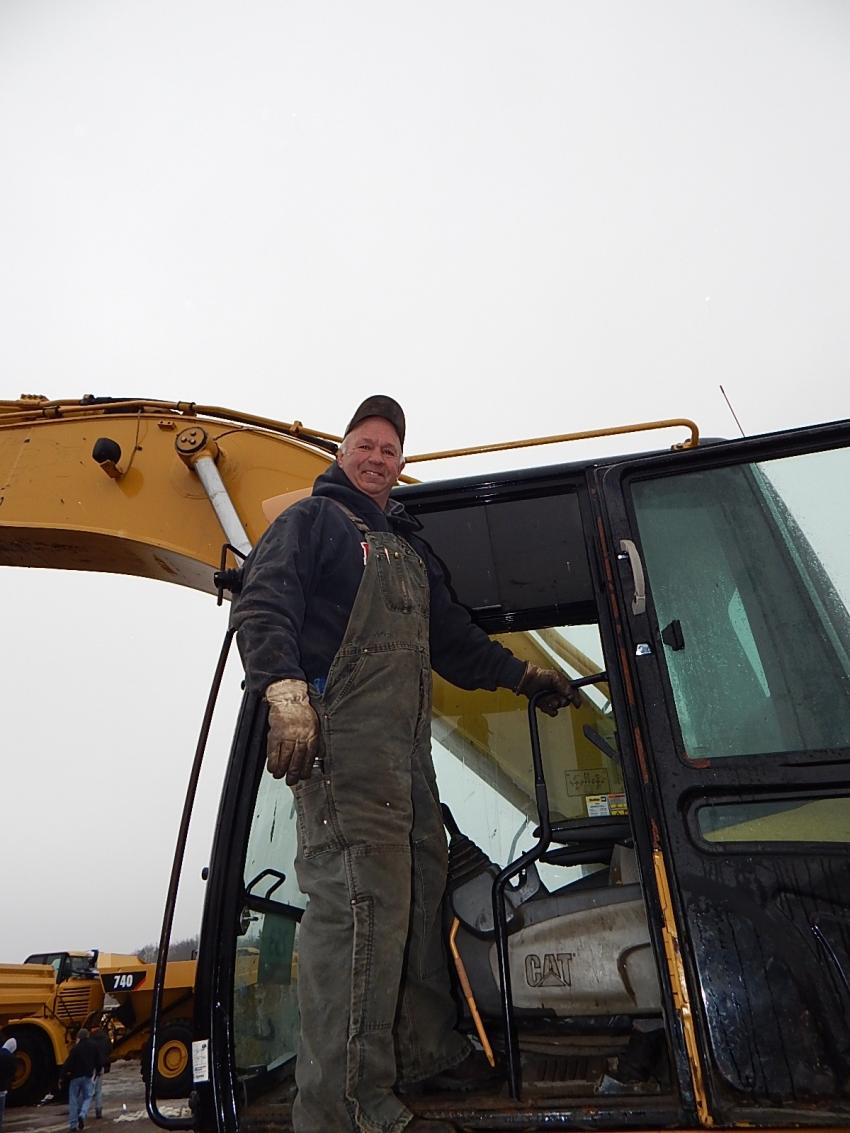 Larry Conrad, owner of Freeway Fab, Dundas Minn., gives this Cat 345C a run-through.