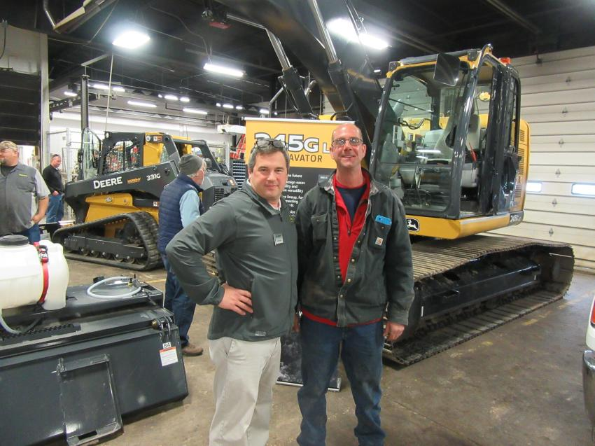 Murphy Tractor & Equipment's Jeff Stopak (L) catches up with E.F.B. Construction President Eric Begue.
