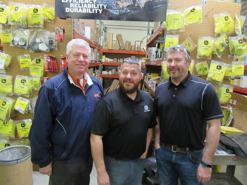 Ken Skala (L) of NPK joined Murphy Tractor & Equipment's Jim Hyde and Kurt Talion at the Painesville Holiday Open House.