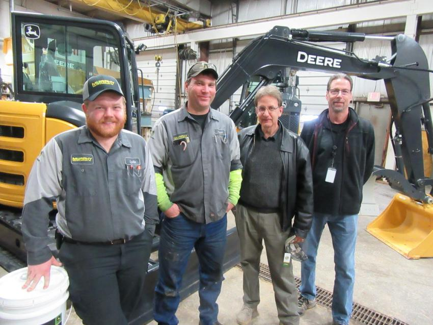 (L-R): Collin Miller and Jason Lange of Murphy Tractor discussed equipment with Dave Romeo and Kevin Stanley of the city of Cleveland at the Brunswick Branch.
