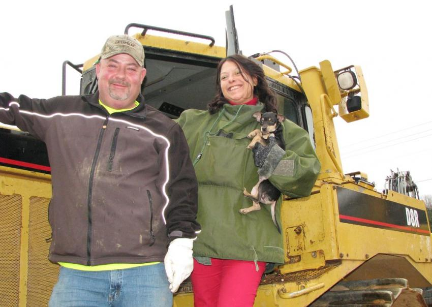 Checking out a Cat D8R dozer of interest are Brian Yancey (L) and Betty Moody (and her dog, Little Rascal) of Contour Grading, Loganville, Ga.