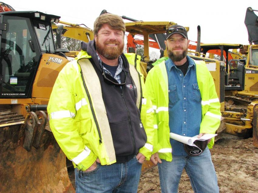 Awaiting the auctioning of the dozers are Jody Bennet (L) and Clint Benefield of Pro Source Utility Contractors, Bowden Junction, Ga.