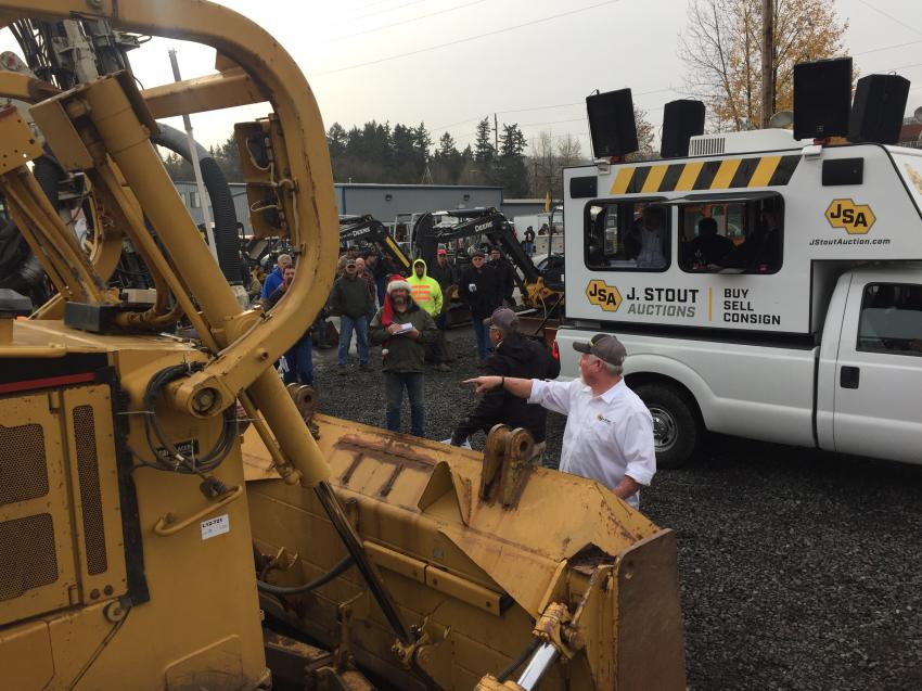 Dozens of bidders take their shot at purchasing one of 10 bulldozers.