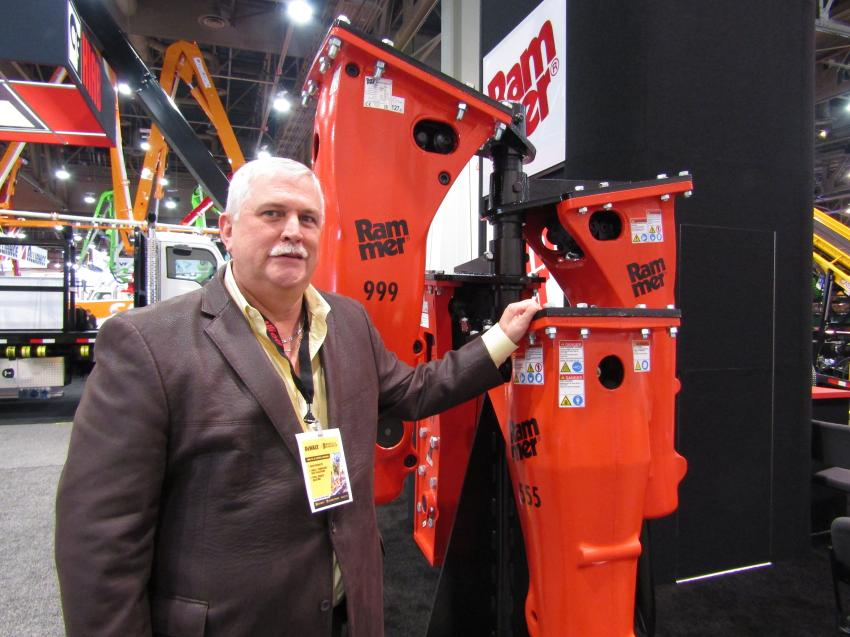 Phil Paranic, president and CEO of Allied Construction Products, stands with the triple digit series hydraulic hammers. This series of hydraulic hammers represents more than 70 percent of all units sold in North America.