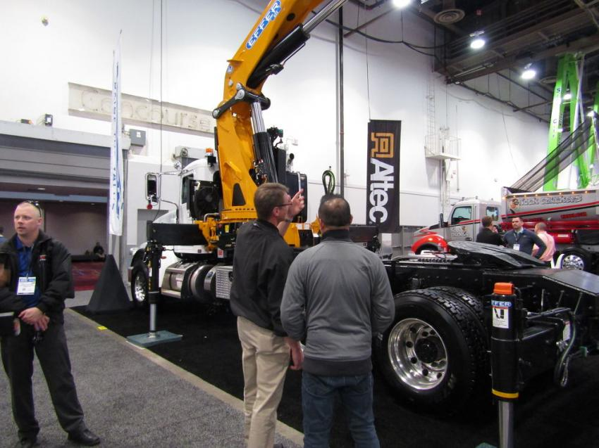 Brent Twombly (L), sales manager of Altec Cranes, points out the features of the Effer 655-5S to an interested buyer. Altec is an exclusive Effer distributor with the largest service and parts network in the United States.