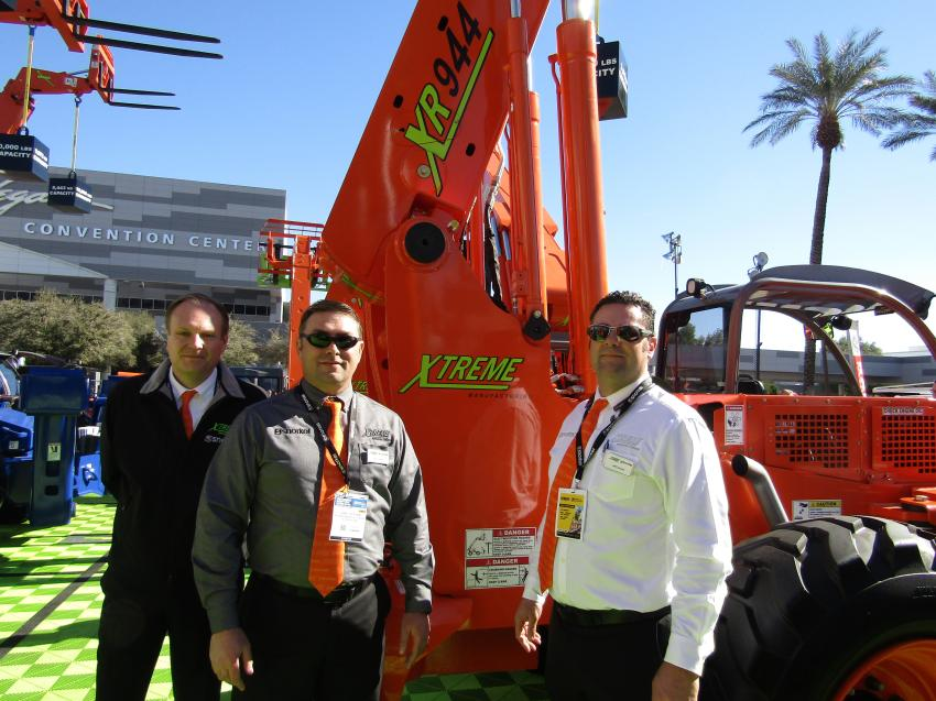 (L-R): Xtreme's Matthew Elvin, CEO; Jamie Graham, vice president of product support; and Jeffrey L. Eckhardt, vice president of engineering, unveil the new Xtreme XR944 rough-terrain telehandler with a 9,000-lb. lift capacity, a maximum lift height of 44 ft. and a maximum forward reach of 28 ft. 10 in.