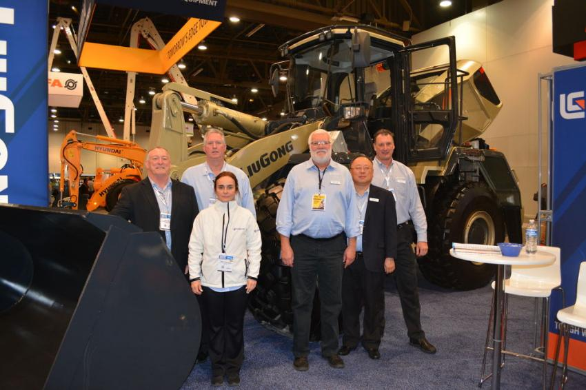 LiuGong introduced its 60th Anniversary Edition wheel loader at World of Concrete in Las Vegas. (L-R): Lewis Miller, regional product support manager; Kevin Lee, vice president of sales and marketing; Michael Watt, excavator product manager; Hugo Chang, wheel loader product manager; Alex Koss, regional sales manager; and Ivana Fiamoncini, marketing coordinator, show off the company's 856 wheel loader, featuring an operating weight of 39,160 lbs. and bucket range capacity of 4.2 cu. yds.