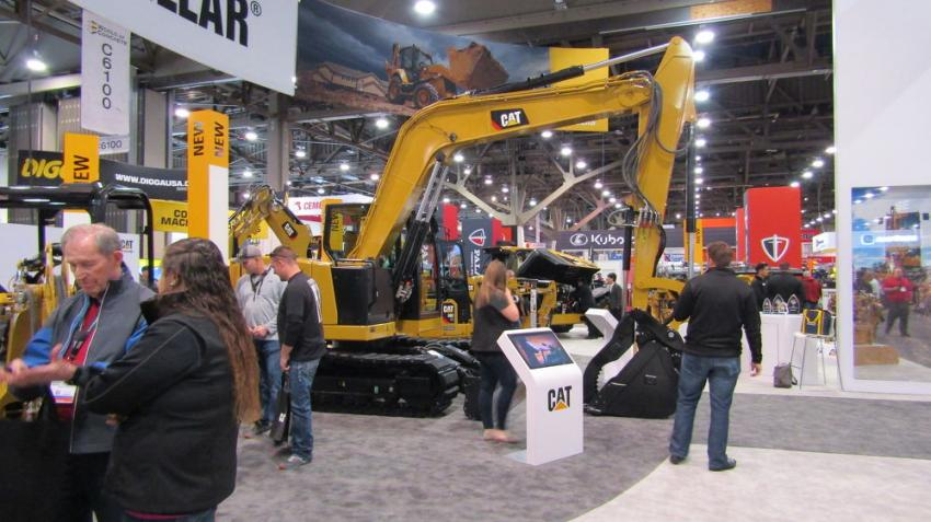 Attendees visit the Caterpillar booth.