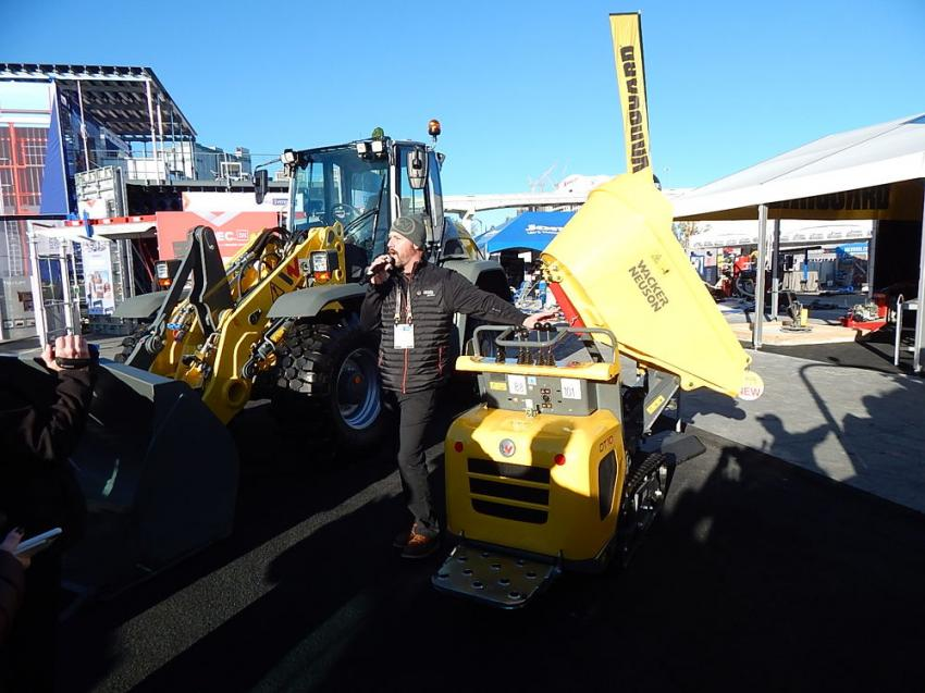 John Dotto, market product manager of Wacker Neuson, holds a press conference to review all the new, innovative Wacker Neuson models brought to WOC 2019. New machines include the WL 95 wheel loader (L), the DT 10 track dumper (R), the RD12 asphalt roller and the newest in a line of internal vibrators.