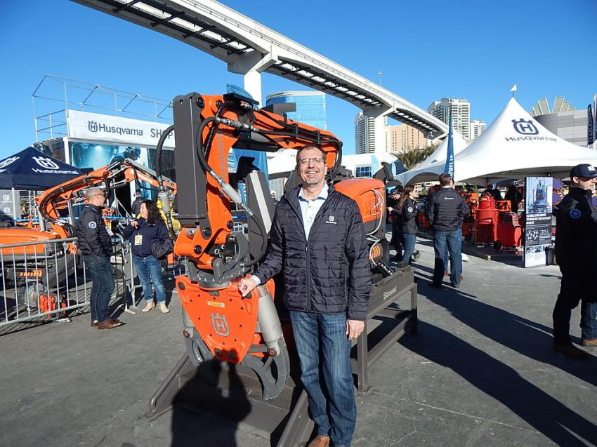 Mark Michaels, director of product management North America of Husqvarna is ready to demonstrate the company's DXR remote demolition robot. The remote-controlled robots were a big hit with convention attendees.