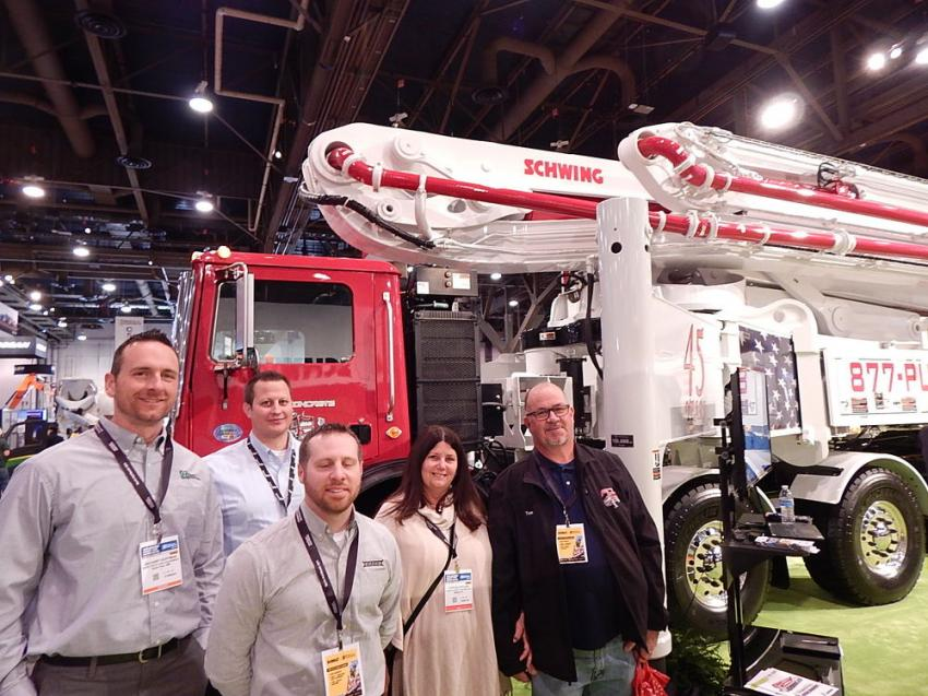 (L-R): Zach Hoffman, technical customer support and training manager; Mike Bloom, director of Mack Truck sales; and Dan Chipman, chassis application engineer, all of Nuss Truck and Equipment, Roseville, Minn., present information to Cynthia and Tom Kitchen, service manager of Florida Concrete Unlimited, Miami Fla., on this Schwing S 65 SXF concrete pump mounted on a Nuss truck body.
