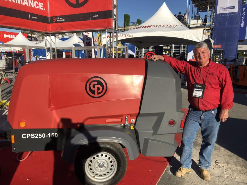 Eric Massinon, business development director of Chicago Pneumatic Power Technique, stands in front of the brand new CPS 250 air compressor.