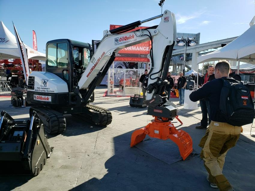 OilQuick representatives gave a demonstration of the company's fully-automatic quick coupling system at World of Concrete.