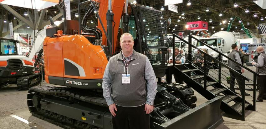 Aaron Kleingartner, marketing manager of Doosan, is at WOC to show off the company's DX140 excavator. The DX140LC delivers durability and reliability.