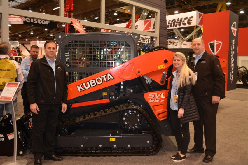 Kubota displayed its full line of loaders and excavators to contractors attending World of Concrete, including their newest track loader, the SVL 65-2.  Shown with the loader are (L-R) Jeff Jacobsmeyer, CE product manager; Meredith Finley, trade show manager; and Tim Boulds, CE operations manager.