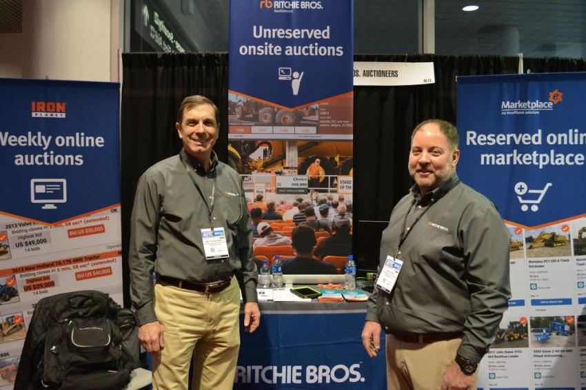 Matt Dougherty (L) and Jeff Fisher manned the Ritchie Bros. Auction booth for the duration of the World of Concrete Expo. Ritchie Bros. sponsors the annual Concrete Industry Management Program (CIM) silent auction held at WOC.