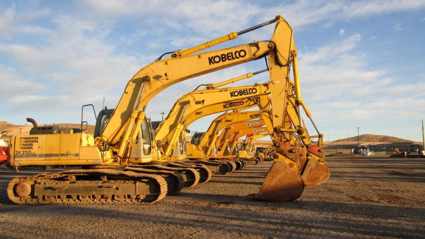 A variety of excavators are lined up ready to go to block.