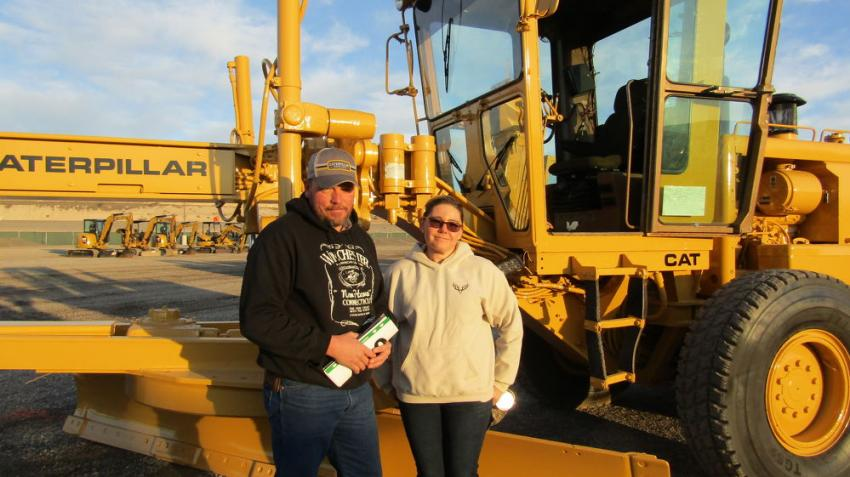 Brandon (L) and Darcy Winget drove all the way from Fillmore, Utah, in hopes of finding some bargains for Brandon's employer, Millard County Road Dept. This 1985 Cat 140G motorgrader is one of several he plans to bid on.
