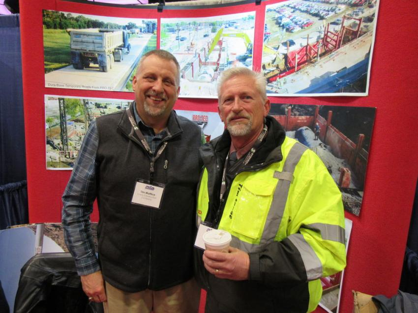 Longtime Pro-Tec Equipment customers Tim Mattice (L) of Lowe Construction and Tim Lange of Michels, who installed the first Pro-Tec slide rail system, paid a visit to the Pro-Tec booth at the show.