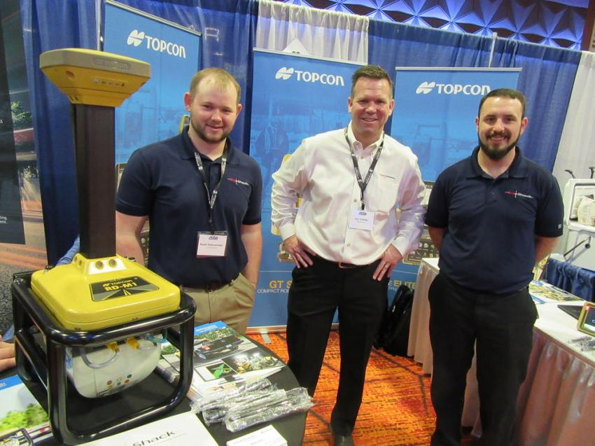 (L-R): Cody Logan, Dan O'Reilly and Adam Kalen of GeoShack were ready to talk about Topcon's RD-M1, a mobile data collection scanner that is part of the Smoothride System, which is capable of surveying highways at highway speeds.