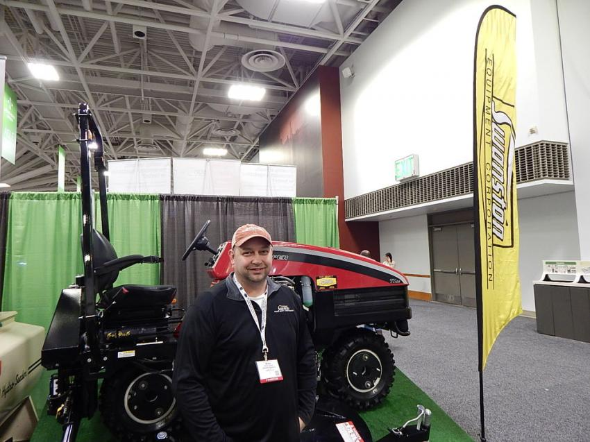 Brock Leagjeld, sales representative with  Swanston Equipment, Fargo, N.D., stands with company's Harper steep slope mowing system.