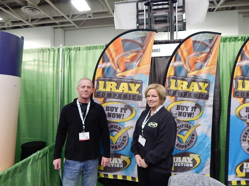 I.R.A.Y. Auction Companies Equipment Sales specialist Don Henry (L) and Jackie Leveille, I.R.A.Y. office support, let attendees know about consigning their equipment for a big construction equipment auction March 8.