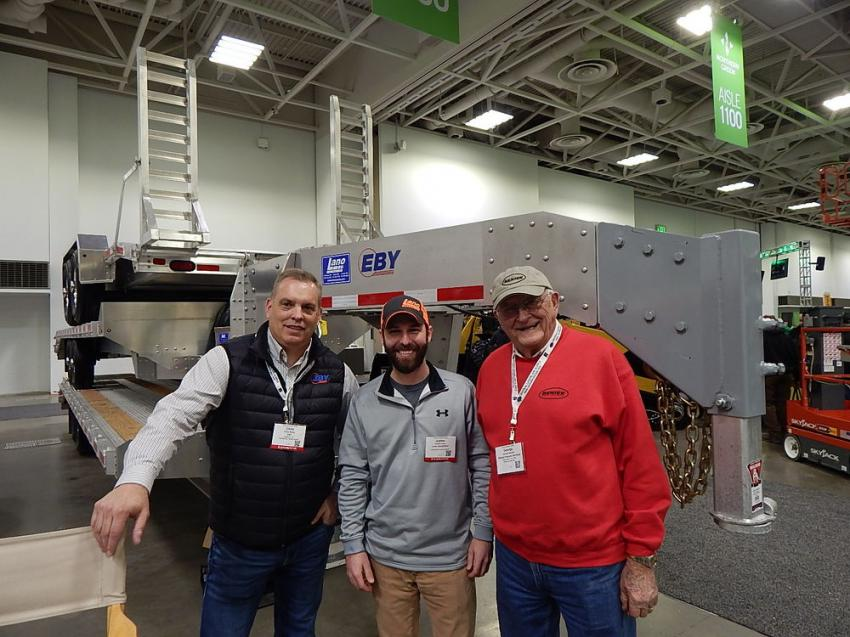 (L-R): At the Lano Equipment booth are Chris Baker, dealer sales rep of EBY Trailers, Blue Bell, Pa.; Juston Lano, manager of the Lano store in Shakopee, Minn.; and George Beniek, owner of Beniek Property Services, Chanhassen, Minn.