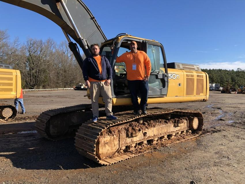 Mikhail Kashpureff (L) and John Caruso of Bean Sprouts LLC in Scranton, Pa., are doing the grading for a new hotel in Greenville and came to the sale looking for a bargain.