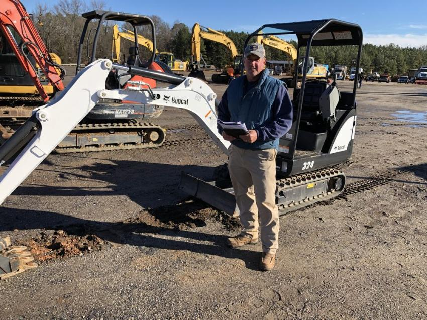 Michael Gilreath of Earth Materials Grading in Anderson, S.C., is a big fan of Bobcat products and looked over a 324 excavator.