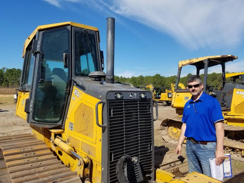 (L-R): Joe Panbianco, Aaron Reicherts and Bud Pecoy, all of Mid Country Machinery, with offices in Iowa and Syracuse, N.Y., are ready to enjoy the great weather and auction