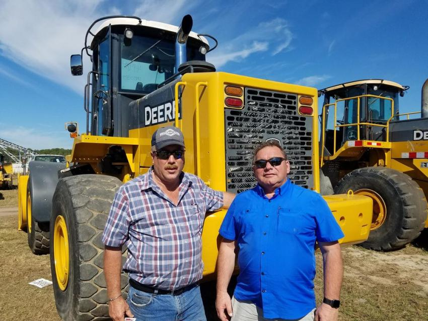 Andy Calder (L) of Andy Calder Excavating and Wilburn Archer of Archer Bulk Carriers, both from Ontario, Canada, stand in front of a John Deere 644J wheel loader.