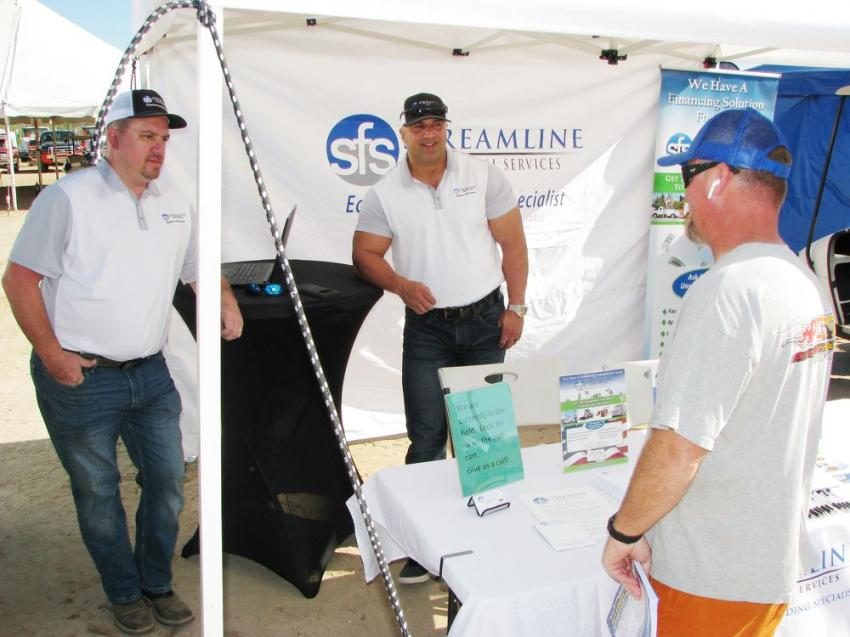 (L-R): Sean Jordan and Guy Selinka of Streamline Financial Services, Atlanta, Ga., speak with Tony Jensen of Pretty Damn Quick (PDQ) Construction, St. George, Utah, about his equipment financing needs.