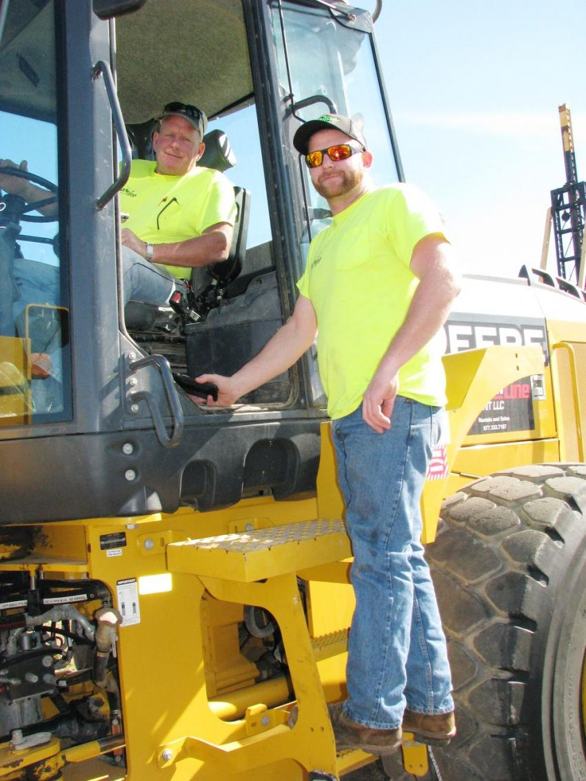Inspecting a John Deere 644K of interest are Ralph Borwegen (L) and Jonathan Borewegen of Borwegen Trucking & Excavation, Greenville, N.Y.