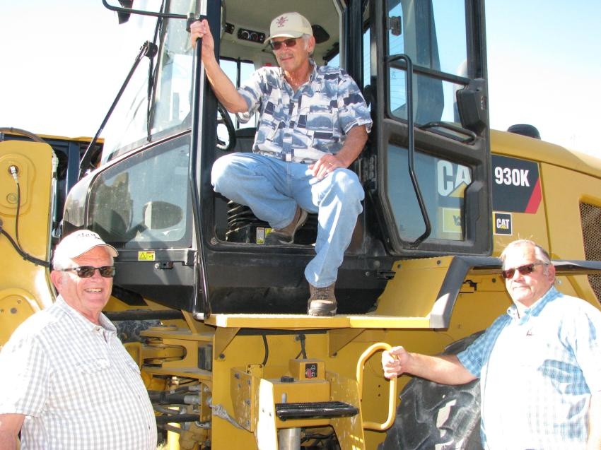 (L-R): Leland Martin, Clay Trucking, Denver, Pa.; Enos Weaver, Weaver Trucking, New Holland, Pa.; and Mel Hurst, Hurst Excavating, Ephrata, Pa., talk about a Caterpillar 930K they're all interested in.