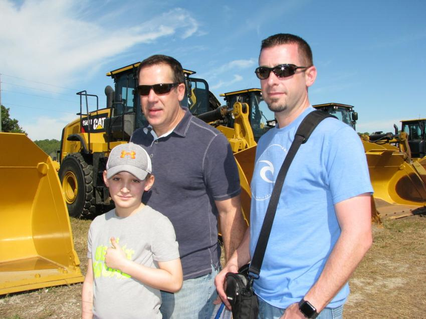 (L-R): Reece Abele, his dad, Jeff Abele, and Lou Taylor of Abele Truck & Equipment, Albany, N.Y., enjoy some warm, sunny days in Florida as they looked for equipment to buy.