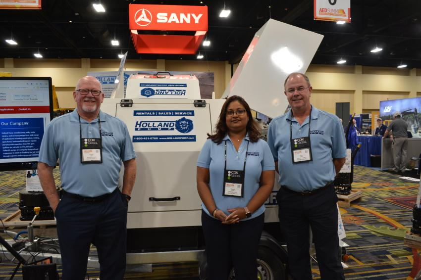 (L-R): Eugene Lant, vice president of Holland Pump, on hand to answer dealers' questions, was joined by Sharlene Hedrick, rental asset manager, and Brian Kieley, pump consultant. Holland manufactures, sells, rents, repairs, and services pumps for the construction industry.