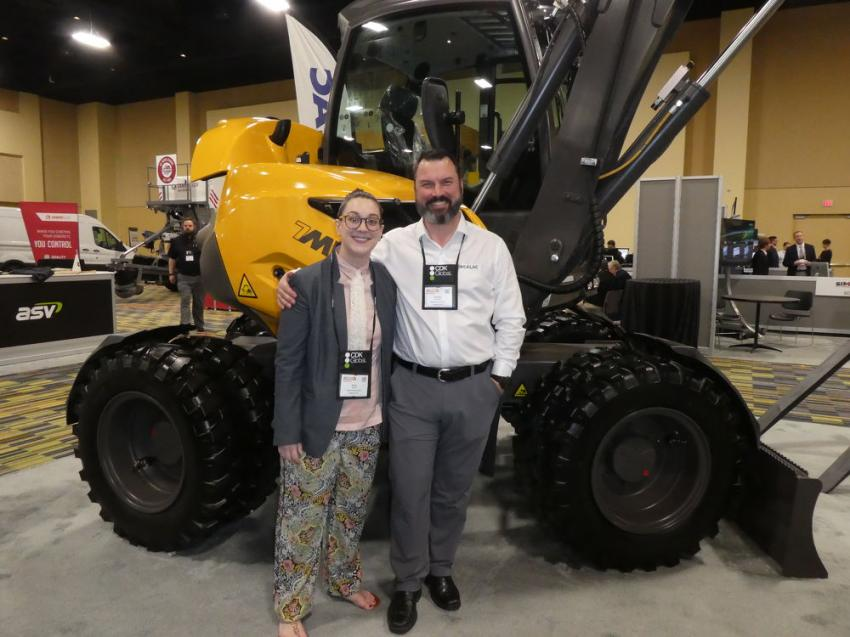 Standing in front of a Mecalac 7MWR machine, representing Mecalac North America, are Nicole Gavin (L), sales and marketing administrator, and Geoffrey Andrews, regional sales representative.