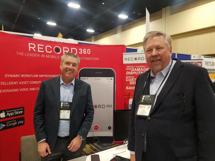 Damon Haber (L) of Record360, Seattle, Wash., chats with Doug Juergensen, COO of Luby Equipment Services, Fenton, Mo., at the Record360 booth.