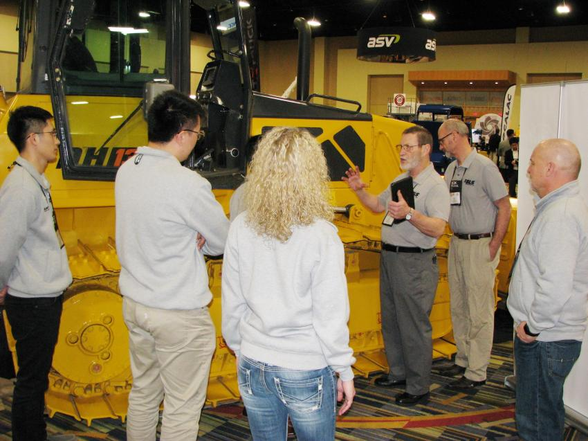 Jim Meyer (third from R) and Michael Wojtal of BLS Enterprises, Bensenville, Ill., go over dozer track-pad applications on the DH13J on display with some of the staff from Shantui, based in Miami, Fla., at their CONDEX exhibit.