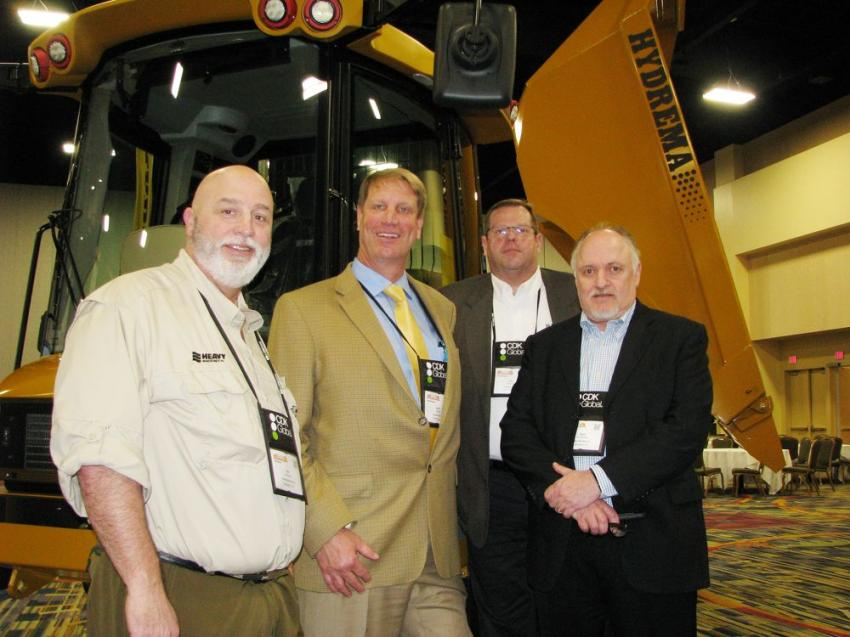 (L-R): Eric Hinshaw, Heavy Machines Inc., Memphis, Tenn.; Barry Ferrell and Tom Hartman of Hydrema, Cumming, Ga.; and Steve Northcross, also of Heavy Machines Inc., get together at the Hydrema exhibit area