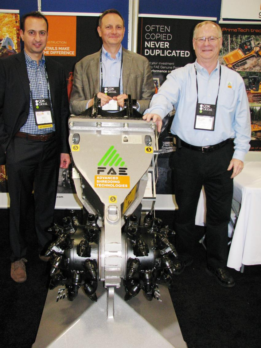 (L-R): Showing off one of FAE's relatively new products, the RC45 rock grinder, one of eight size-class rock grinders available from FAE, are Fabrizio Bastone, Giorgio Carrera and Chris Koch of FAE USA, Flowery Branch, Ga.