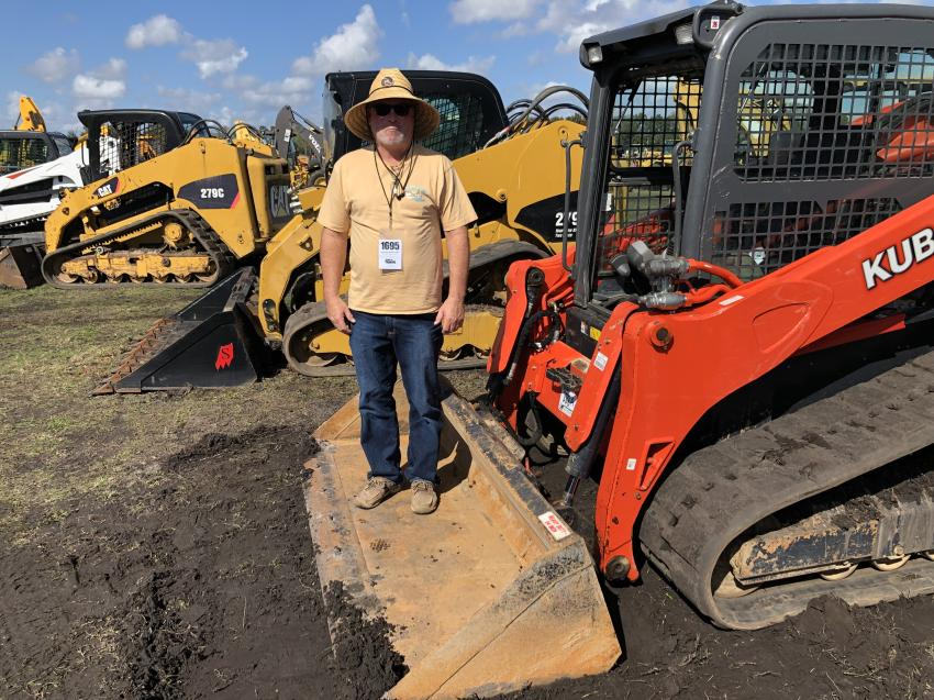Steve Cooper of Cooper Recycling, Livingston, Tenn., looks over the Kubota and Caterpillar compact track loaders.