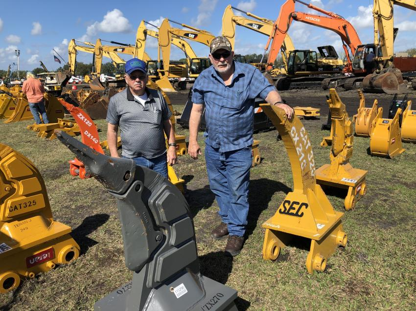 Donnie Houck (L) and Wayne Barker, both of Wayne Barker Construction, Lansing, N.C., look over attachments.