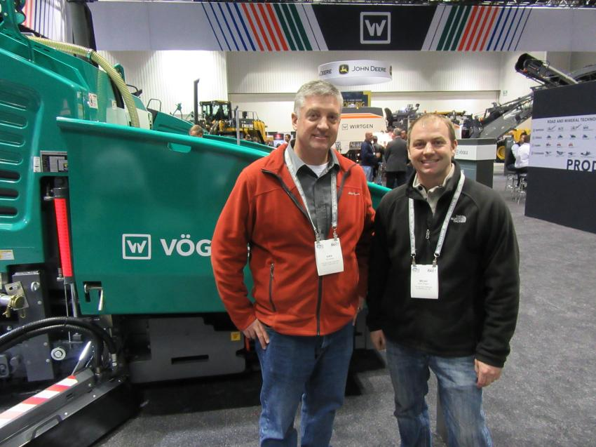 Kirk Sidwell (L) and Micah Gregory of the McLean Company, Columbus, Ohio, stopped in at the Wirtgen equipment display to take in the latest Vogele, Hamm and Kleemann machines.