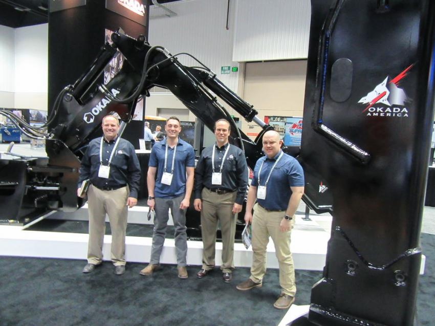 (L-R): Okada America's Chris Cadum, Adam Daher, Jim Brown and Mike Kane were ready to discuss the company's Pedestal Rock Breaker Boom Series Model 12S and ORV Series hydraulic breakers.